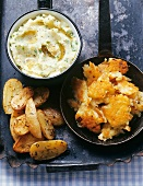 Crushed potatoes, roast potatoes with caraway & potato cakes