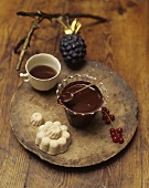 Chocolate and pear jam in a glass on a wooden board