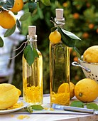 Home-made lemon oil in two bottles out of doors