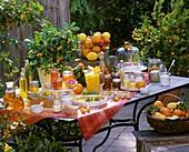 Still life: citrus fruit & citrus fruit dishes out of doors