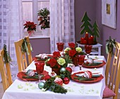 Christmas table decorated with carnations, pine, baubles