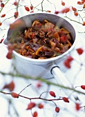 Rose hip and quince chutney in sauteuse pan, rose hips