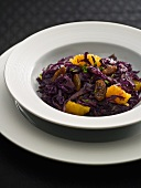 Red cabbage salad with orange segments and sultanas