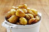 Glazed sweet chestnuts in an enamel pot