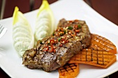 Grilled steak and pumpkin with avocado puree
