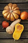 Pumpkin, butternut- & Hokkaido squashes on wooden background