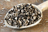 Dried black cohosh root on a wooden spoon