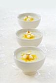 Three bowls of cauliflower soup with saffron