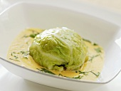 Savoy cabbage leaf stuffed with goose liver in white wine sauce