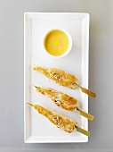 Fried turkey breast skewers with curry dip