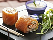 Smoked salmon rolls filled with vegetable sticks