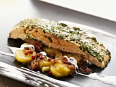 Salmon with herb and mustard crust on fried potatoes