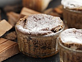Chocolate soufflés in glass dishes, cooking chocolate