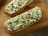 Soft cheese, sardines, capers and dill on slices of toast