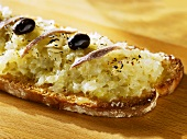 Onion, Parmesan and anchovies on wholemeal toast
