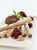 Mousse au chocolat with wafer rolls and cherries