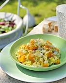 Pumpkin risotto with leeks and herbs out of doors