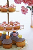 Cupcakes with coloured icing on a tiered stand