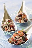 Poached oysters with tomatoes & red wine reduction on spoons