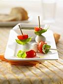 Mozzarella and cocktail tomatoes on three cocktail sticks