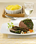Beef fillet in herb coating with potato gratin