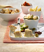 Cheese fondue with mixed pickles