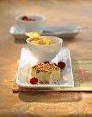Star-shaped coconut-cinnamon ice cream with nuts, raspberries, physalis