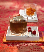 Chocolate dessert with liqueur cream in a glass