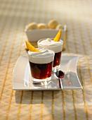Two glasses of orange coffee with vanilla cream