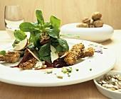 Corn salad with turkey breast in nut crust (autumnal)