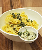 Tagliatelle with nut and herb butter in a bowl