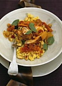 Chicken & vegetable stir-fry with dried fruit, couscous, mint