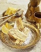 Three pieces of lemon cake with metal tableware