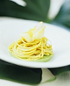 Saffron spaghetti with fried zander on basil puree