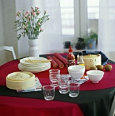 Laid table with bamboo steamer, rice and tableware