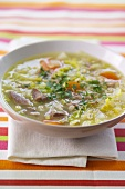 Barley and vegetable soup with added meat