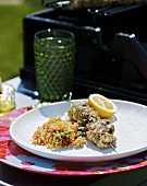 Grilled monkfish kebab with couscous in the open air