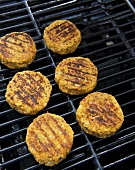 Chick-pea burgers on a grill