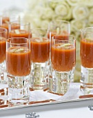 Gazpacho in glasses on a tray at a wedding reception