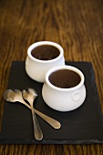 Hot chocolate in two pots with spoons