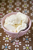 Ricotta in a bowl with a spoon
