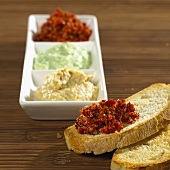 Tomato, avocado and aubergine spreads with white bread