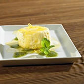Quark soufflé with lime sauce and basil pesto