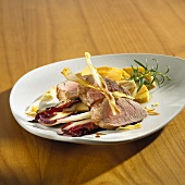 Roast pork fillet on Treviso radicchio, caramelised quinces