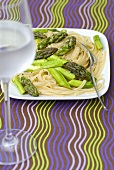 Tagliatelle with green asparagus and a glass of water