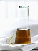 Lime blossom tea in a glass bottle