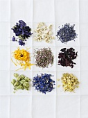 Various dried medicinal flowers on a cloth