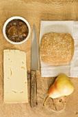 Cheddar cheese, apple chutney, bread and a pear