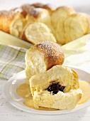 Buchteln (sweet yeast dumplings) with plum puree & custard