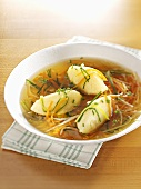 Semolina dumpling soup with shredded vegetables